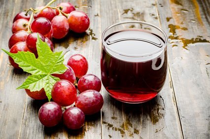 Fresh red grape and juice on wooden background,healthy food